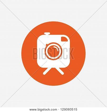 Hipster photo camera sign icon. Retro camera on tripod symbol. Orange circle button with icon. Vector