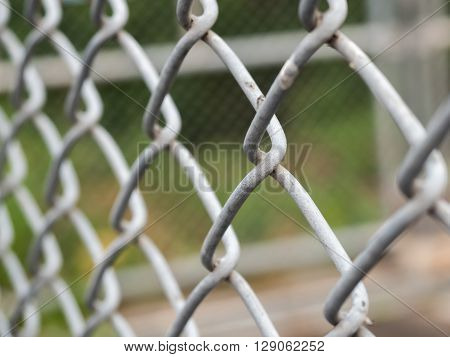Steel Chain Link Fence Background Texture, selective focus