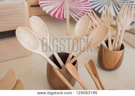Wooden Spoon In Wooden Container