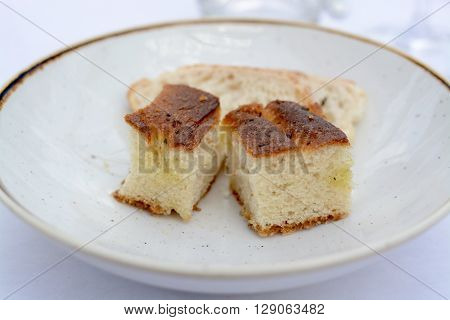 Focaccia bread starter served on a white plate