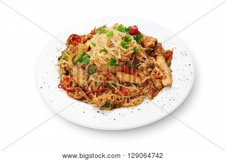 Asian food. Fried Thai Rice noodles with meat and vegetables. Chinese rice vermicelli with meat, parsley and peppers.