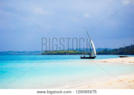 Small wooden boat in stunning turquoise water