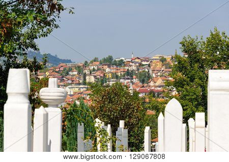 SARAJEVO BOSNIA AND HERZEGOVINA - SEPTEMBER 4 2009: Alifakovac cemetery tombstones and view of the old Bistrik town