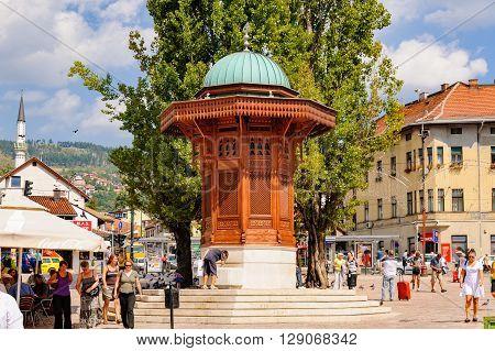 SARAJEVO BOSNIA AND HERZEGOVINA - SEPTEMBER 4 2009: The Sebilj wooden water fountain (Sebil) at Bascarsija square