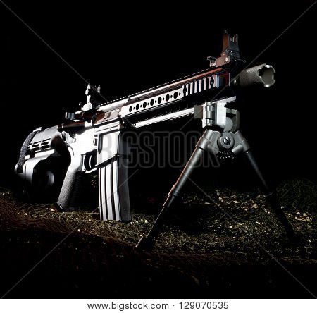 Modern sporting rifle in a pistol on a dark background