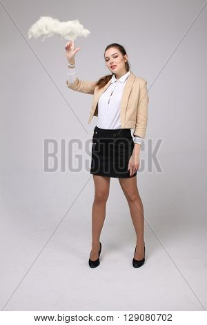 Young woman holding tablet and cloud, cloud computing concept