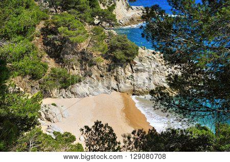 a view of the Cala den Carles beach in Tossa de Mar, Costa Brava, Catalonia, Spain