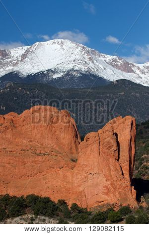 Close up view of Pikes Peak Mountain in Colorado Springs with a red rock formation in the foreground