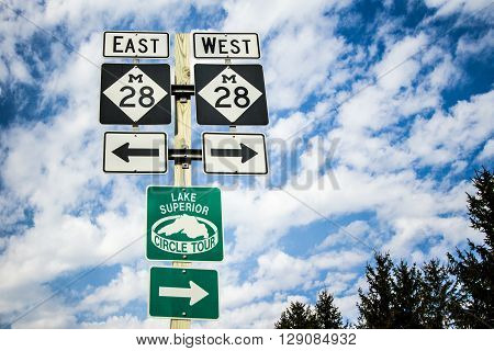 Munising, Michigan, USA - May 7, 2016: Highway M-28 travels east west through Michigan's Upper Peninsula along the shores of Lake Superior. It is a major thoroughfare for tourists and residents throughout Marquette, Sault Ste. Marie and Newberry.