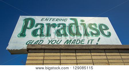 Paradise, Michigan, USA - May 7, 2016: Welcome sign for the small village of Paradise, Michigan. This small town lies on the shores of Lake Superior and has an approximate population of 500.