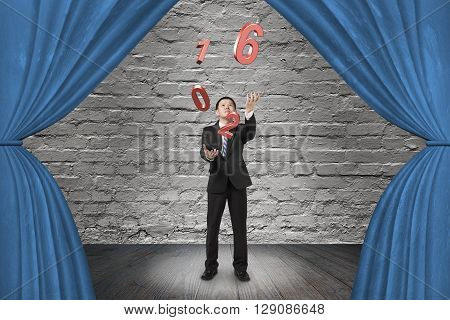 Businessman catching throwing 2016 red words on red curtain stage with spotlight on old brick wall background. 3D Rendering