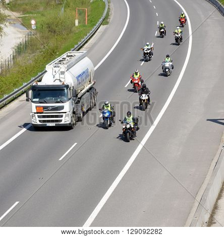 Dolny Hricov Slovakia - April 30 2016: Cistern truck preceded by group of motorbikers on slovak D1 highway