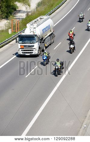 Dolny Hricov, Slovakia - April 30 2016: Cistern truck preceded by group of motorbikers on slovak D1 highway