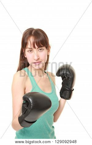 portrait of female boxer throws a right uppercut on white background