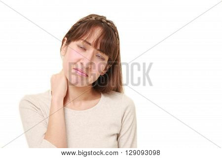 portrait of young woman suffers from neck ache