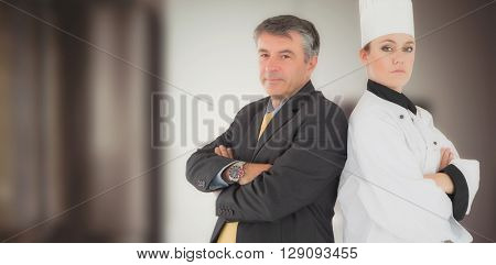 Portrait of chef and businessman back to back against image of kitchen equipment
