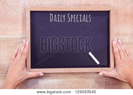 Daily specials message against hand writing on chalkboard