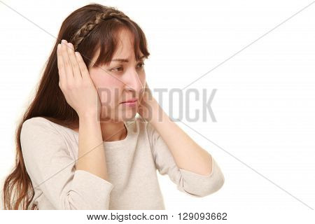 portrait of Young woman suffers from noise