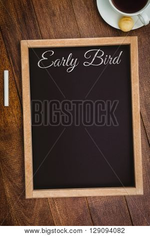 Early bird message against view of a big blackboard