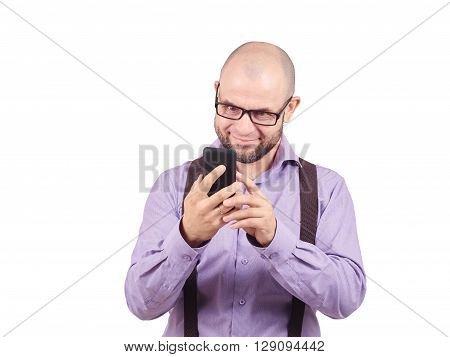 Bald Man Startled Looks At The Phone.