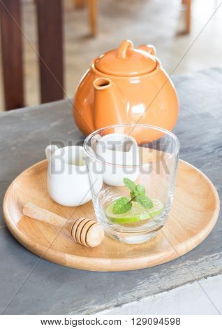 Hot pot of honey lime healthy drink, stock photo