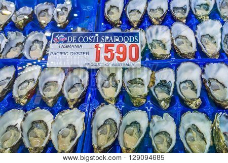 Sydney Australia - November 11 2014: Fresh Pacific oyster on the Famous Sydney Fish Market Sydney New South Wales Australia.. 52 tonnes of seafood are selling at auction on this market every day.