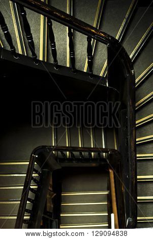 Wooden staircase in an old building. View from above