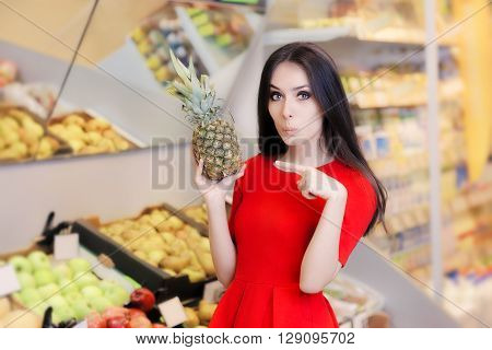 Funny Woman with Pineapple Fruit in Supermarket