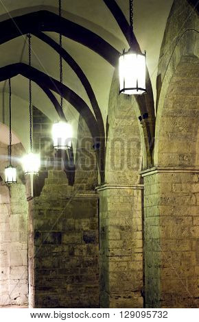 Marble Arcades with retro lamps in Brescia, Italy.