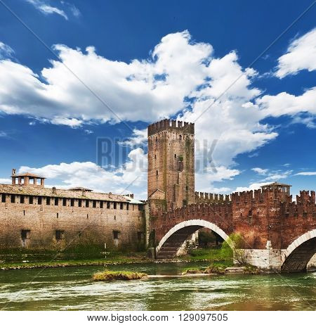 View of Adige river and medieval stone bridge.