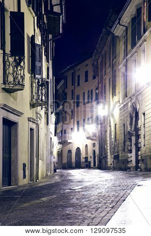 Night Street in the old part of the city of Brescia in Italy