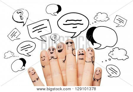 communication, family, people and body parts concept - close up of two hands showing fingers with smiley faces over text clouds