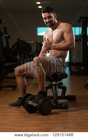 Young Man In Gym Giving A Thumbs Up