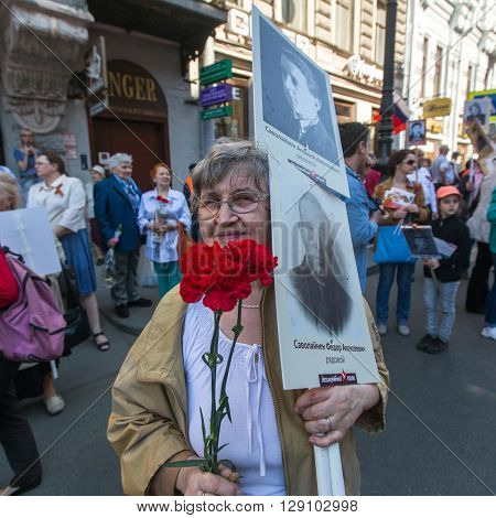 St.PETERSBURG, RUSSIA - MAY 9, 2016: Participants of Immortal Regiment -  international public action, which takes place in Russia and some countries of near and far abroad in the Victory Day - May 9.
