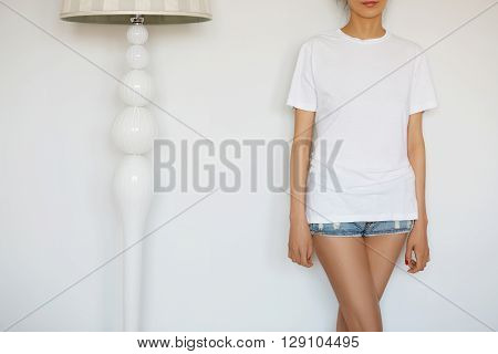 Cropped Isolated View Of Young Casual Woman. Female Teenager Posing In New Clothes Against White Stu