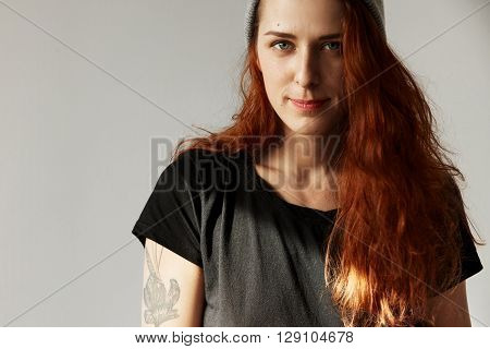 Headshot Of Beautiful Caucasian Woman Wearing Casual Clothes Looking Seriously At The Camera, Posing