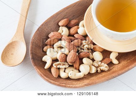 Assorted mixed nuts Almond Cashews nuts macadamia walnut with hot chinese tea
