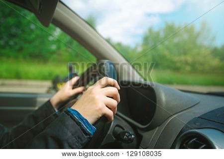 Female hands gripping car steering wheel woman driving