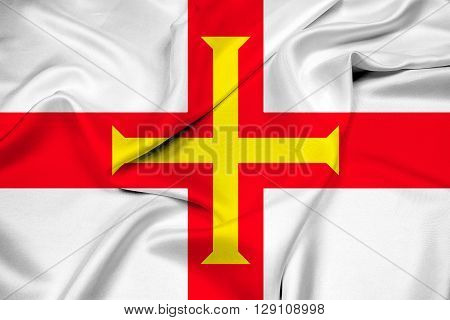 Waving Flag of Guernsey, with beautiful satin background.