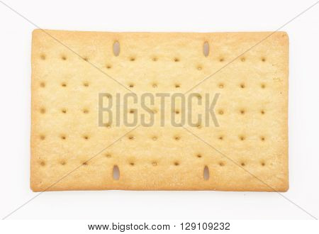 One biscuit or cracker on white background