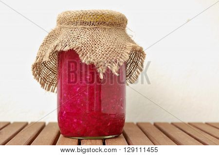 Sauerkraut And Red Beet In The Glass On The Wooden Background