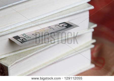 Book with five dollar bookmark, One dollar banknote used as book marker
