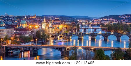 Prague, Czech Republic bridges panorama with historic Charles Bridge and Vltava river at night