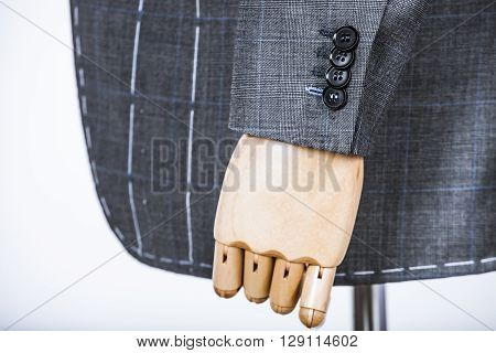Details of a tailored suit jacket with markings on it for stitching cutting and tailoring