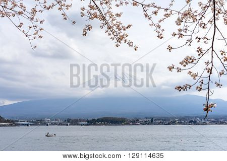 Mt. Fuji view in a cloudy sky from the shore of Lake Kawaguchi in Japan
