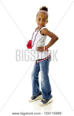 Full length image of a sassy elementary girl proudly wearing her red, white and blue.  On a white background.