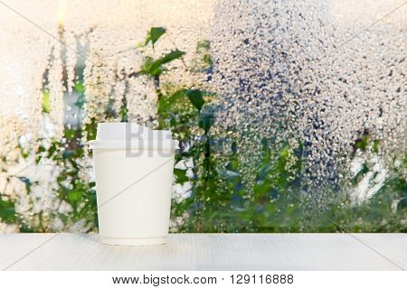 White Disposable Coffee Cup On A Table Nearing Rainy Day Window Background., On The Morning.