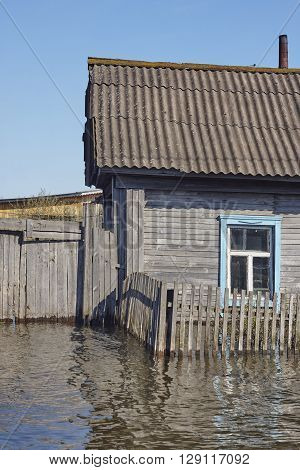 Old house in water Flood in West Siberia.
