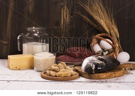 Healthy food, natural sources of protein over wooden table. Selective focus