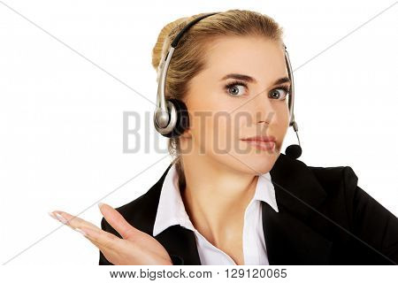 Young helpline operator thinking about something